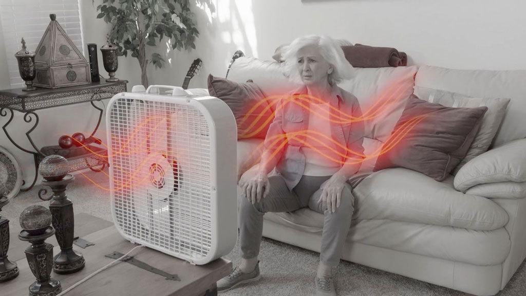 Woman in front of box fan