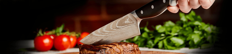 Blade cutting through steak