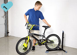 Boy backing his bike into the Bike Nook
